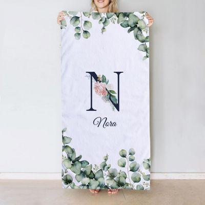 Handdoek met monogram en tekst
