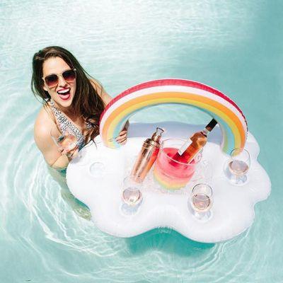 Strand & Water - Drijvende wolkenbar met regenboog