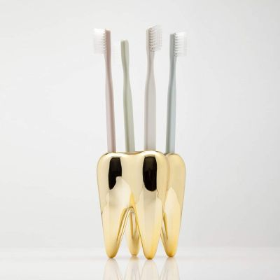 Cadeau voor broer - Gouden tand tandenborstelhouder